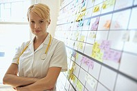 Nurse standing beside schedule (thumbnail)