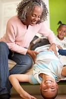 Grandmother Tickling Grandson