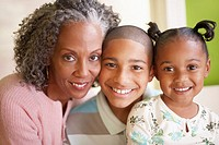 Grandmother and Grandchildren Smiling (thumbnail)