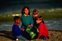 Children with globe on the beach, MR
