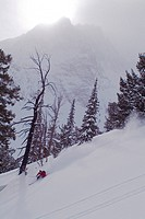 A man skiing powder snow in the Sawtooth Mountains of Idaho near Mount Williams.