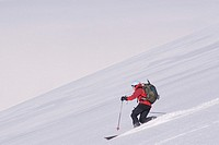 A woman skiing on a glacier on Mount Vsesevidov in te Aleutian Islands in Alaska.