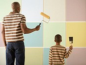 Father and Son Preparing to Paint