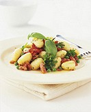 Gnocchi with ham and peas, close-up