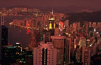 Aerial view of the lights of Hong Kong skyline and Hong Kong Harbor at night, China.