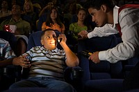 Kid Using Cell Phone at the Movies