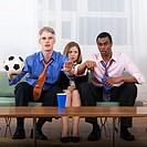 Two Soccer Fans and Woman on Couch
