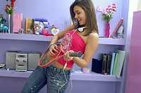 Teenage Girl Playing Guitar on Tennis Racket