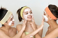 Teenage Girls Applying Face Cream