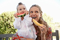 Mother and Daughter Eating Fresh Fruit