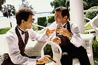 Father and his son toasting with wine