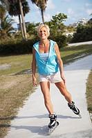 Older Woman Rollerblading