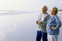Senior couple standing on the beach
