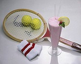 Milkshake and a tennis racket with two tennis balls