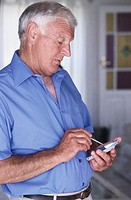 Senior Man Using Palm Pilot