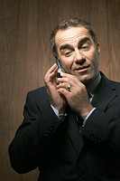 Mature businessman using mobile phone