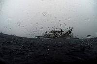 Philippines, boat in rain