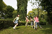Group of children (6-8) playing on grass