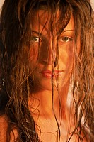 Hispanic woman with wet hair looking at camera