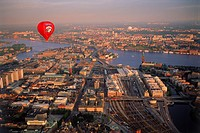 Red hot air balloon floating over Stockholm at sunset