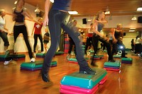 Indoor step aerobics or stepping classes