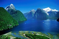 The Lion Peak above Milford Sound with ferryboats in Fiordland National Park South Island New Zealand