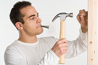 Man Hammering Nails