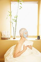 Woman Relaxing with Facial Mask