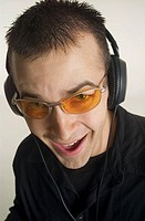 DJ wearing headphones, portrait