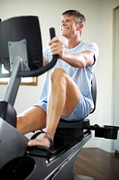 Businessman Exercising at Health Club