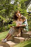Mother Reading to Son on Garden Steps