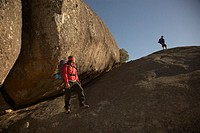 Two Hikers Standing on Rock Area (thumbnail)