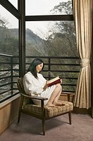 Woman Reading Book in Robe (thumbnail)