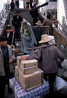 Stick-stick men, porters, carry products up stairs, transport, commerce, morning in town of Wuxi, China, Asia, 042503