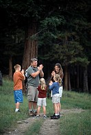 A family of five enjoy a hiking game on a trail in Rocky Mtn Nat´l Park, CO