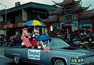 Mickey and Minnie Mouse from Disneyland gets a ride through Chinatown, Los Angeles, in the New Years Parade
