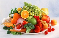 Composition of mixed fruit and vegetables on plate