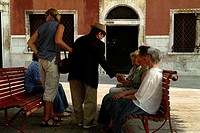 Tourists resting on benches, Venice, Veneto, Italy