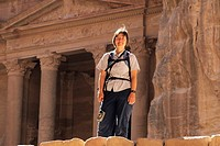 Tourist in front of The Treasury, Petra Jordan Middle East.