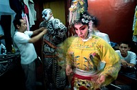 Close-up of a female opera performer getting dressed, China
