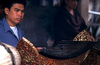 Close-up of a young man playing a xylophone, Thailand