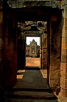 Temple seen through an old door, Thailand