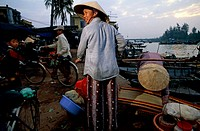 Rear view of a man selling baskets, Vietnam