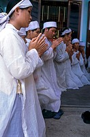 Group of people praying, Vietnam