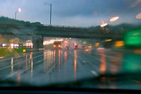 Cars driving along wet road at dusk 2006. New Jersey Turnpike, USA