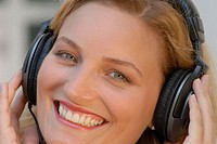 Young woman with headphones enjoying music.