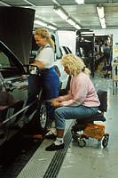 Women on auto assembly line at Saab-Scania Plant in Sweden