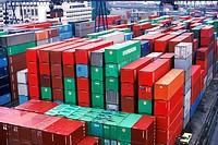 Cargo containers stacked in Singapore Harbor