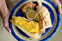 Vegetarian plate - cheese tamale and refried beans.
