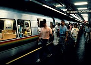 Passengers move along platform as they exit a train in Caracas, Venezuela´s modern Metro system.